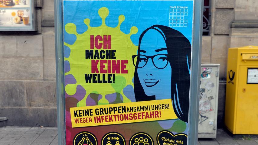 Corona-Shutdown, Tag 68: Die Stadt Erlangen warnt mit Plakaten vor Gruppenansammlungen.