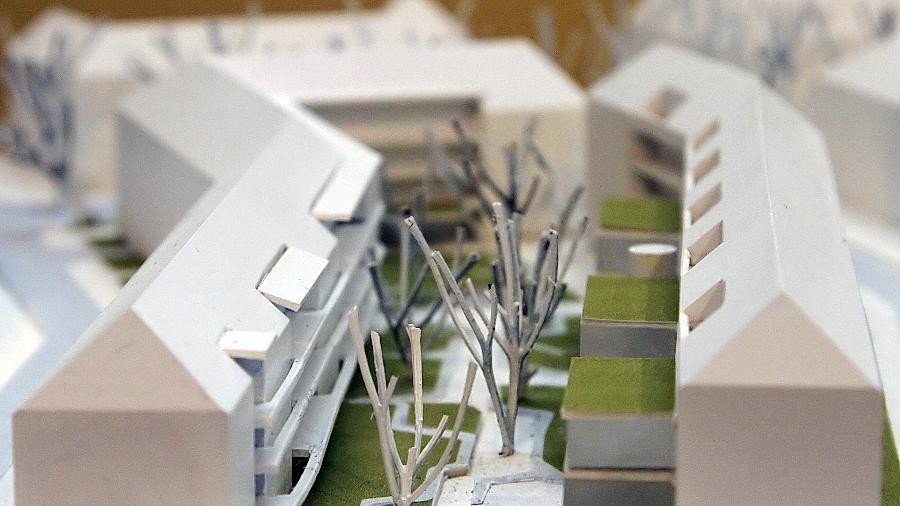 """Akzente nach innen setzt das """"IQ""""-Projekt mit Dachterrassen, dreigeschossigen Kuben, Laubengängen,  Spielbereichen und viel Grün."""