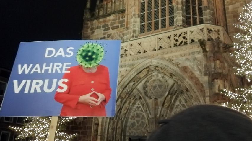 Protesters against Angela Merkel , Demonstration von Corona-Leugner in Hauptmarkt Platz during in the Hard Lockdown of the Covid 19 Coronavirus Pandemie in Nuremberg Nurnberg , Bayern , Deutschland . January 03 , 2021.