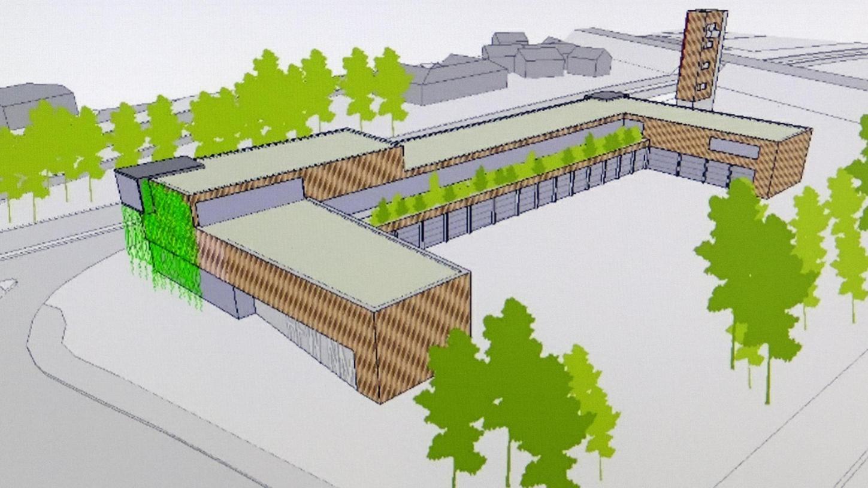 """Die neue Feuerwache bildet ein lang gestrecktes """"U"""", das sich in Richtung des Alten Kanals öffnet. Im Erdgeschoss befinden sich die Fahrzeughallen. Werkstätten und Funktionsräume sind darüber."""
