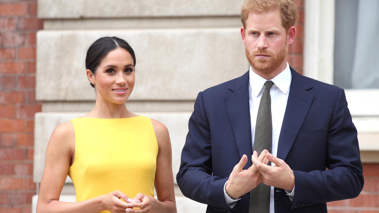 Prinz Harry von Großbritannien und seine Frau Meghan während des Empfangs