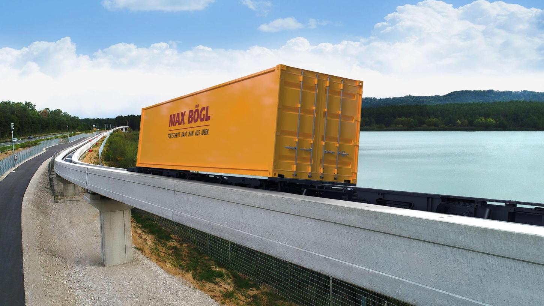 Die Bauunternehmung Bögl lässt Container schweben: Hier auf der Teststrecke am Baggersee in Greißelbach, bald auch im Hamburger Hafen. Dort stellt sie bis Oktober ein wegweisendes Pilotprojekt auf Stelzen.