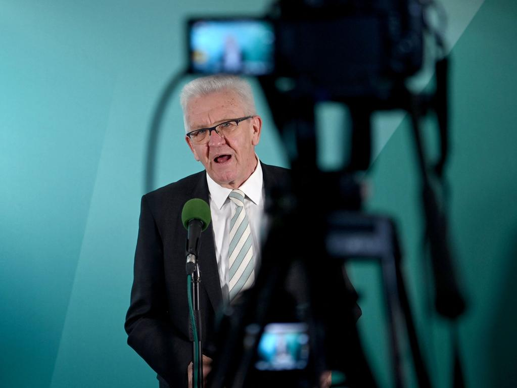 Baden-Wuerttemberg's State Premier and top candidate of the Greens Winfried Kretschmann addresses a pres conference after exit poll results are published at the state parliament (Landtag) in Stuttgart, southern Germany, at the end of state elections in Baden-Wuerttemberg on March 14, 2021. - Germans went to the polls in two key regional elections, with German Chancellor Angela Merkel's conservatives bracing for a drubbing on anger over a corruption scandal and a series of pandemic setbacks. The votes for new regional parliaments in the states of Rhineland-Palatinate and Baden-Wuerttemberg are seen as a bellwether ahead of September 26 general elections -- which will be the first in over 15 years not to feature Merkel. (Photo by Marijan Murat / POOL / AFP)