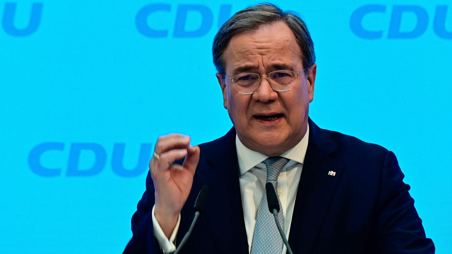 Armin Laschet, head of Germany's conservative Chritian Democratic Union (CDU) party, gives a press statement at the start of the participation campaign for the CDU election program for the general elections, in Berlin on March 30, 2021. (Photo by Tobias Schwarz / various sources / AFP)