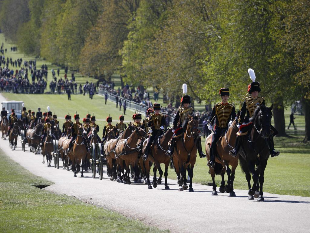 Members of the King's Troop Royal Horse Artillery ride up the Long Walk to Windsor Castle in Windsor, west of London, on April 17, 2021 for the funeral of Britain's Prince Philip, Duke of Edinburgh. - Philip, who was married to Queen Elizabeth II for 73 years, died on April 9 aged 99 just weeks after a month-long stay in hospital for treatment to a heart condition and an infection. (Photo by PHIL NOBLE / various sources / AFP)
