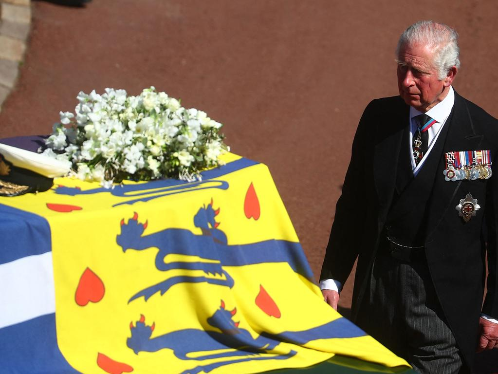 Britain's Prince Charles, Prince of Wales walks during the ceremonial funeral procession of Britain's Prince Philip, Duke of Edinburgh to St George's Chapel in Windsor Castle in Windsor, west of London, on April 17, 2021. - Philip, who was married to Queen Elizabeth II for 73 years, died on April 9 aged 99 just weeks after a month-long stay in hospital for treatment to a heart condition and an infection. (Photo by HANNAH MCKAY / POOL / AFP)