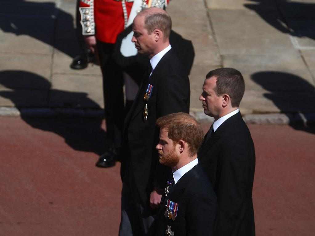 Britain's Prince William, Duke of Cambridge (top), Peter Phillips and Britain's Prince Harry, Duke of Sussex follow the coffin of Britain's Prince Philip, Duke of Edinburgh to St George's Chapel in Windsor Castle in Windsor, west of London, on April 17, 2021. - Philip, who was married to Queen Elizabeth II for 73 years, died on April 9 aged 99 just weeks after a month-long stay in hospital for treatment to a heart condition and an infection. (Photo by HANNAH MCKAY / POOL / AFP)