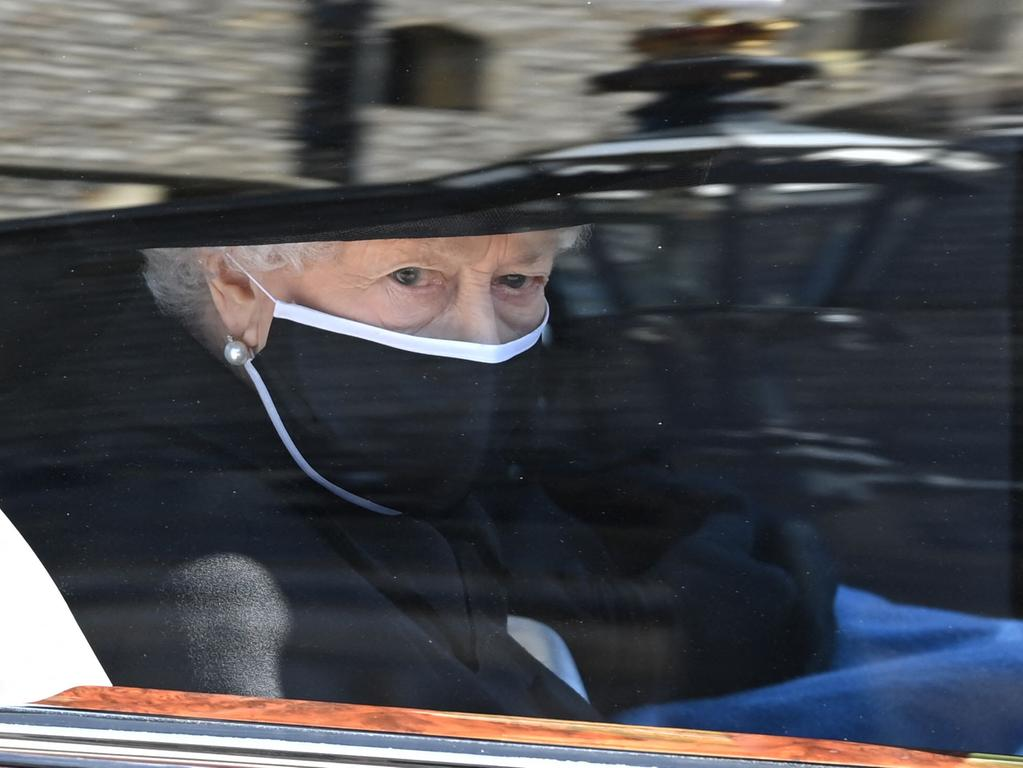 Britain's Queen Elizabeth II arrives in the Royal Bentley at the funeral for her husband, Britain's Prince Philip, Duke of Edinburgh to St George's Chapel in Windsor Castle in Windsor, west of London, on April 17, 2021. - Philip, who was married to Queen Elizabeth II for 73 years, died on April 9 aged 99 just weeks after a month-long stay in hospital for treatment to a heart condition and an infection. (Photo by LEON NEAL / POOL / AFP)
