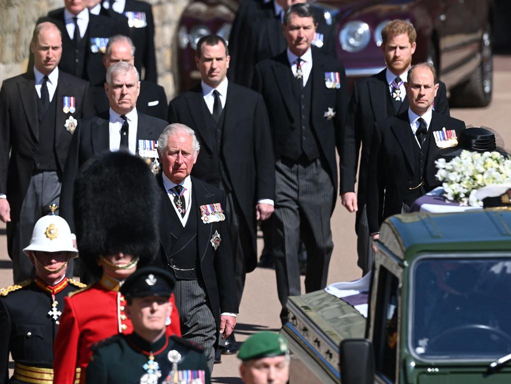 Britain's Prince Charles, Prince of Wales (front), Britain's Prince William, Duke of Cambridge, (back-L) and Britain's Prince Harry, Duke of Sussex, (2R) walk during the ceremonial funeral procession of Britain's Prince Philip, Duke of Edinburgh to St George's Chapel in Windsor Castle in Windsor, west of London, on April 17, 2021. - Philip, who was married to Queen Elizabeth II for 73 years, died on April 9 aged 99 just weeks after a month-long stay in hospital for treatment to a heart condition and an infection. (Photo by LEON NEAL / POOL / AFP)