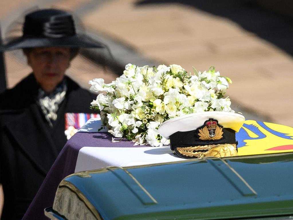 Britain's Princess Anne, Princess Royal, follows the coffin during the ceremonial funeral procession of Britain's Prince Philip, Duke of Edinburgh to St George's Chapel in Windsor Castle in Windsor, west of London, on April 17, 2021. - Philip, who was married to Queen Elizabeth II for 73 years, died on April 9 aged 99 just weeks after a month-long stay in hospital for treatment to a heart condition and an infection. (Photo by LEON NEAL / POOL / AFP)
