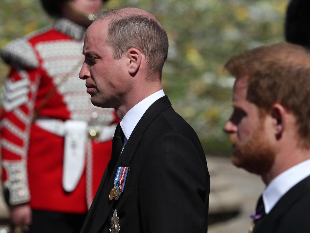 ALTERNATIVE CROP VERSION - Britain's Prince William, Duke of Cambridge (L) and Britain's Prince Harry, Duke of Sussex follow the coffin during the ceremonial funeral procession of Britain's Prince Philip, Duke of Edinburgh to St George's Chapel in Windsor Castle in Windsor, west of London, on April 17, 2021. - Philip, who was married to Queen Elizabeth II for 73 years, died on April 9 aged 99 just weeks after a month-long stay in hospital for treatment to a heart condition and an infection. (Photo by Gareth Fuller / various sources / AFP) / ALTERNATIVE CROP VERSION