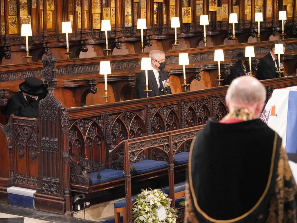 Britain's Queen Elizabeth II (L) and Britain's Prince Andrew, Duke of York attend the funeral service of Britain's Prince Philip, Duke of Edinburgh inside St George's Chapel in Windsor Castle in Windsor, west of London, on April 17, 2021. - Philip, who was married to Queen Elizabeth II for 73 years, died on April 9 aged 99 just weeks after a month-long stay in hospital for treatment to a heart condition and an infection. (Photo by Jonathan Brady / POOL / AFP)