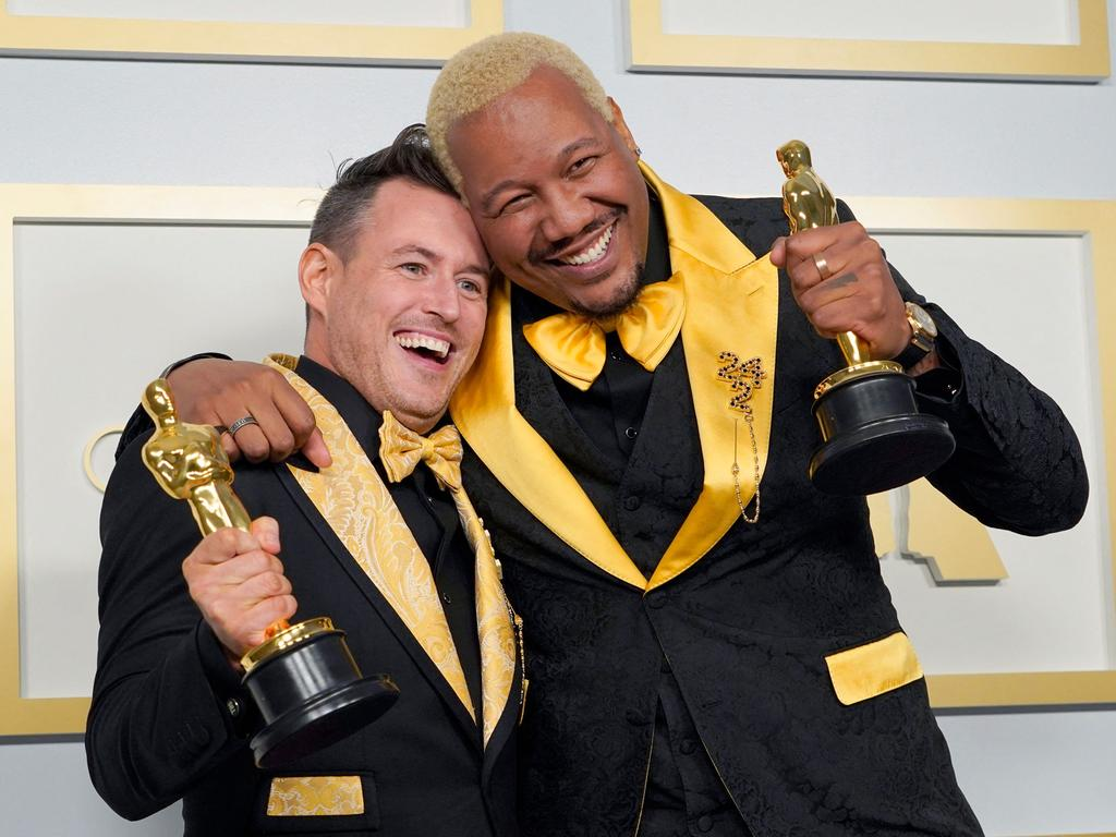 Martin Desmond Roe (L) and Travon Free (R) pose with the Oscar for Best Live Action Short Film for