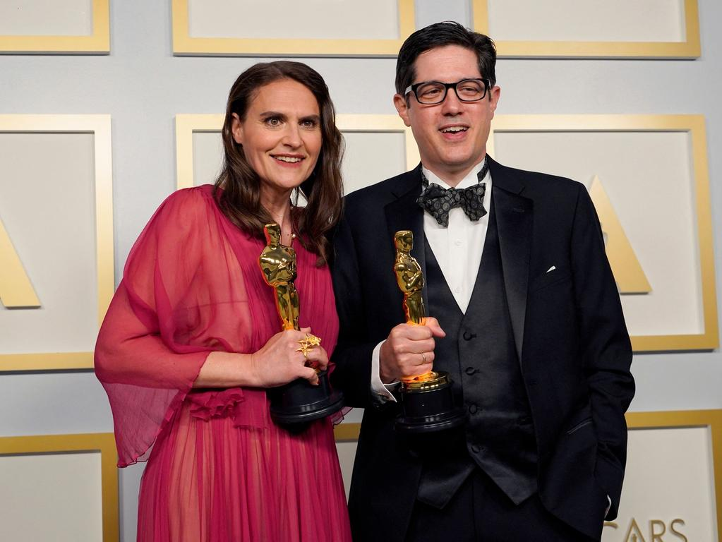 Alice Doyard (L) and Anthony Giacchino pose with the award for best documentary short subject for