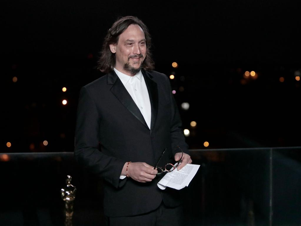 French composer Nicolas Becker celebrates after winning the award for Best Sound for