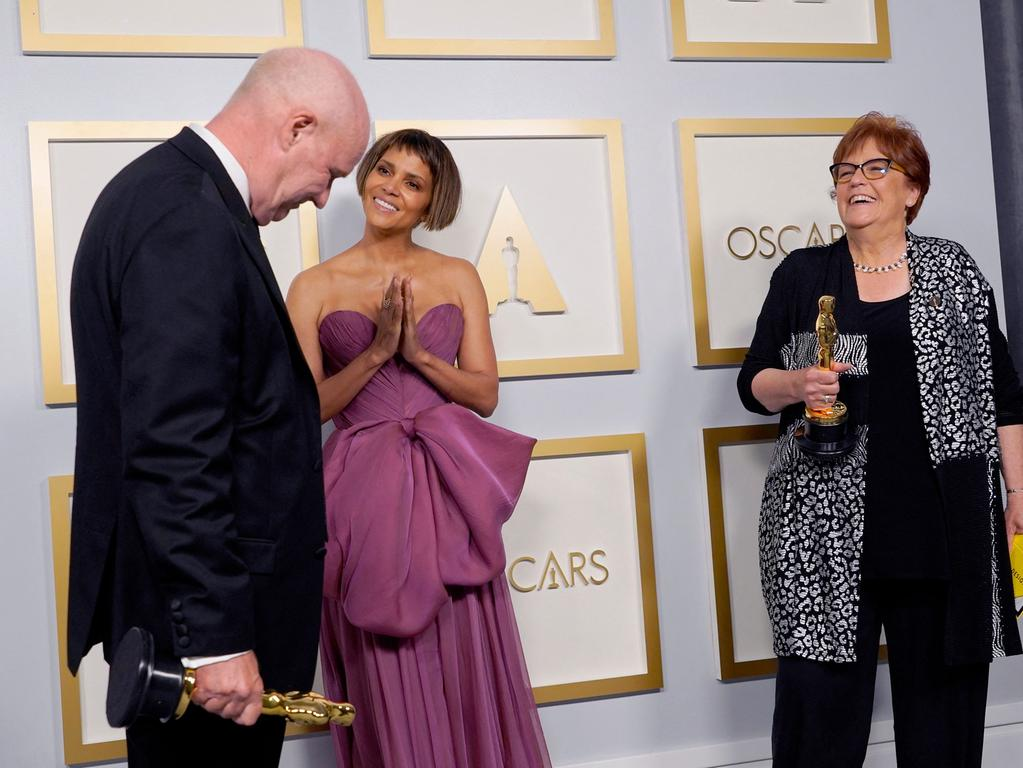 Donald Graham Burt (L) and Jan Pascale (R), winners of the award for best production design for