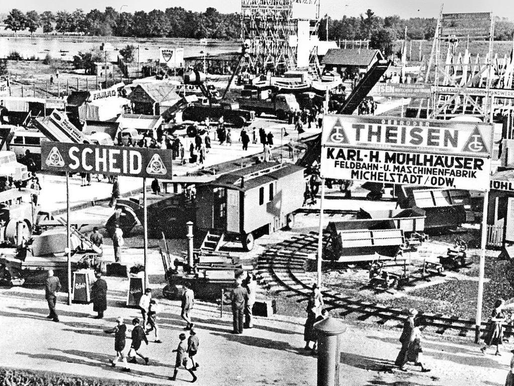 Auf der Deutschen Bauausstellung 1949 war die Firma Gebrüder Theisen aus Nürnberg mit Baumaschinen, Baugeräten und Werkstatteinrichtungen vertreten.