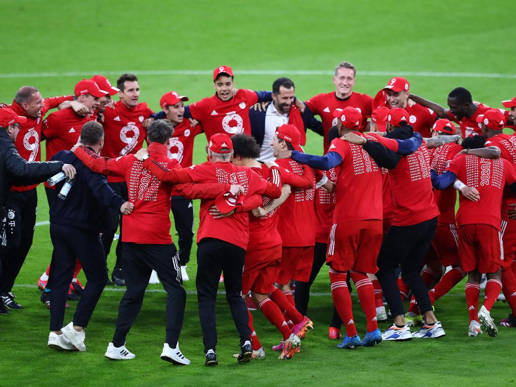 Bayern Munich's players and team members celebrate after the German first division Bundesliga football match FC Bayern Munich v Borussia Moenchengladbach in Munich, southern Germany on May 8, 2021. (Photo by MATTHIAS SCHRADER / POOL / AFP) / DFL REGULATIONS PROHIBIT ANY USE OF PHOTOGRAPHS AS IMAGE SEQUENCES AND/OR QUASI-VIDEO