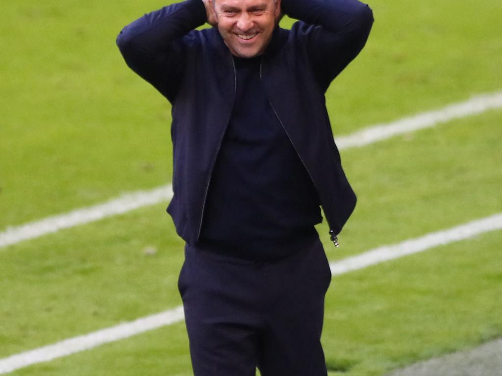 Bayern Munich's German head coach Hans-Dieter Flick reacts during the German first division Bundesliga football match FC Bayern Munich v Borussia Moenchengladbach in Munich, southern Germany on May 8, 2021. (Photo by MATTHIAS SCHRADER / POOL / AFP) / DFL REGULATIONS PROHIBIT ANY USE OF PHOTOGRAPHS AS IMAGE SEQUENCES AND/OR QUASI-VIDEO   ALTERNATIVE CROP