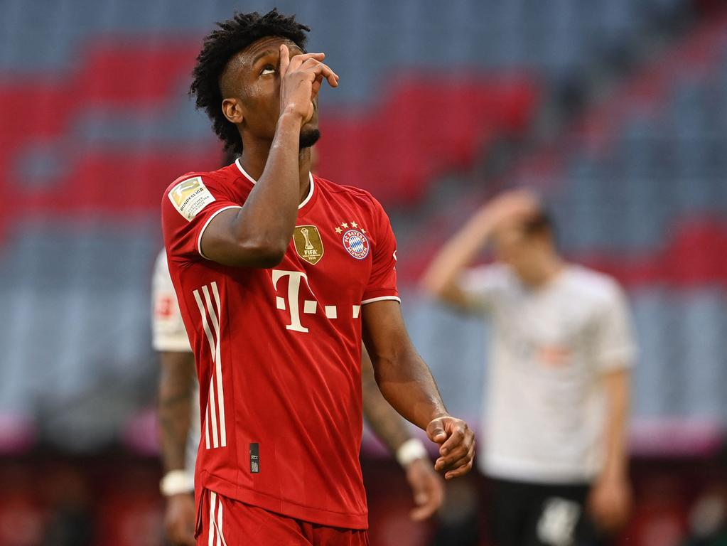 Bayern Munich's French forward Kingsley Coman celebrates scoring the 4-0 goal during the German first division Bundesliga football match FC Bayern Munich v Borussia Moenchengladbach in Munich, southern Germany on May 8, 2021. (Photo by CHRISTOF STACHE / POOL / AFP) / DFL REGULATIONS PROHIBIT ANY USE OF PHOTOGRAPHS AS IMAGE SEQUENCES AND/OR QUASI-VIDEO