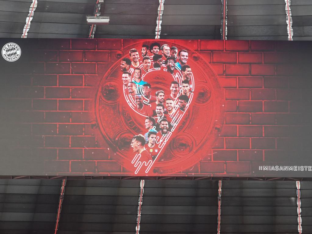 A display featuring the players, the trophy and the number 9 is seen prior to the German first division Bundesliga football match FC Bayern Munich v Borussia Moenchengladbach in Munich, southern Germany on May 8, 2021. - Bayern Munich won the Bundesliga for the ninth time in a row after Leipzig lost to Dortmond earlier in the day. (Photo by Christof STACHE / POOL / AFP) / DFL REGULATIONS PROHIBIT ANY USE OF PHOTOGRAPHS AS IMAGE SEQUENCES AND/OR QUASI-VIDEO