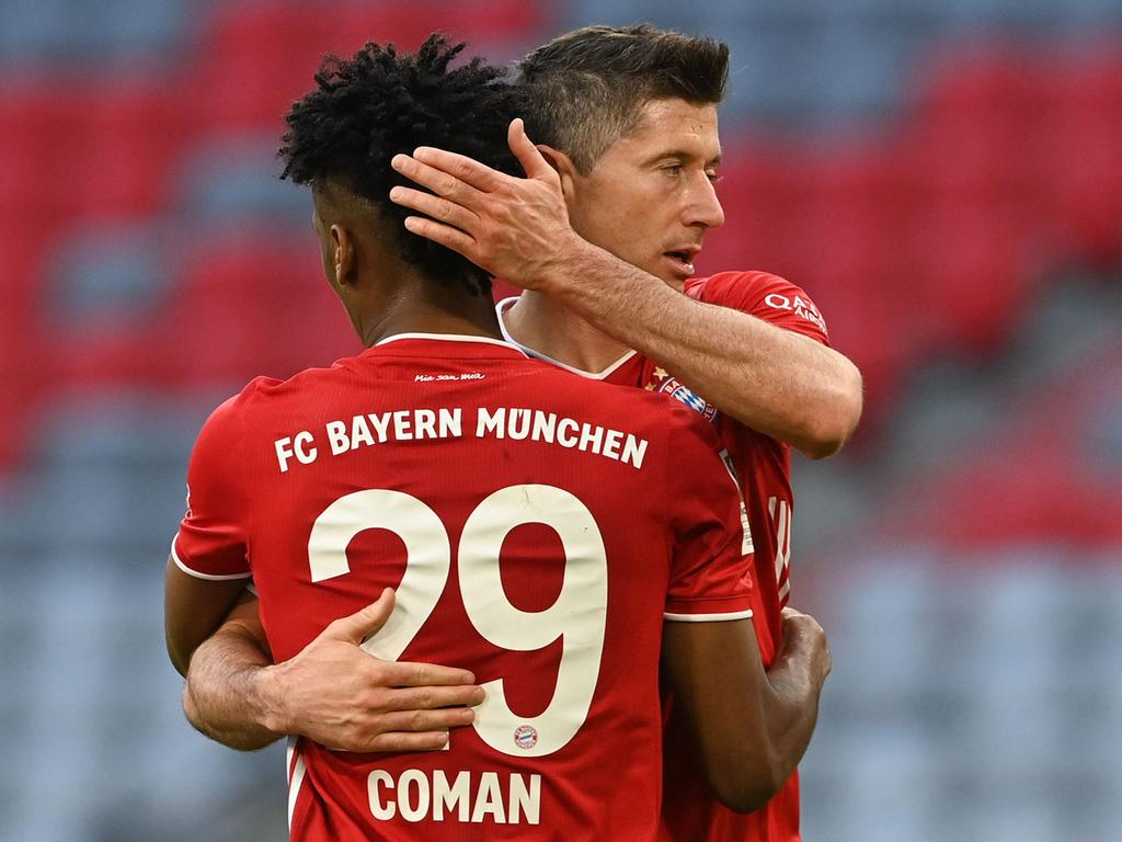 Bayern Munich's French forward Kingsley Coman (L) celebrates scoring the 4-0 goal with his team-mate Bayern Munich's Polish forward Robert Lewandowski during the German first division Bundesliga football match FC Bayern Munich v Borussia Moenchengladbach in Munich, southern Germany on May 8, 2021. (Photo by CHRISTOF STACHE / POOL / AFP) / DFL REGULATIONS PROHIBIT ANY USE OF PHOTOGRAPHS AS IMAGE SEQUENCES AND/OR QUASI-VIDEO
