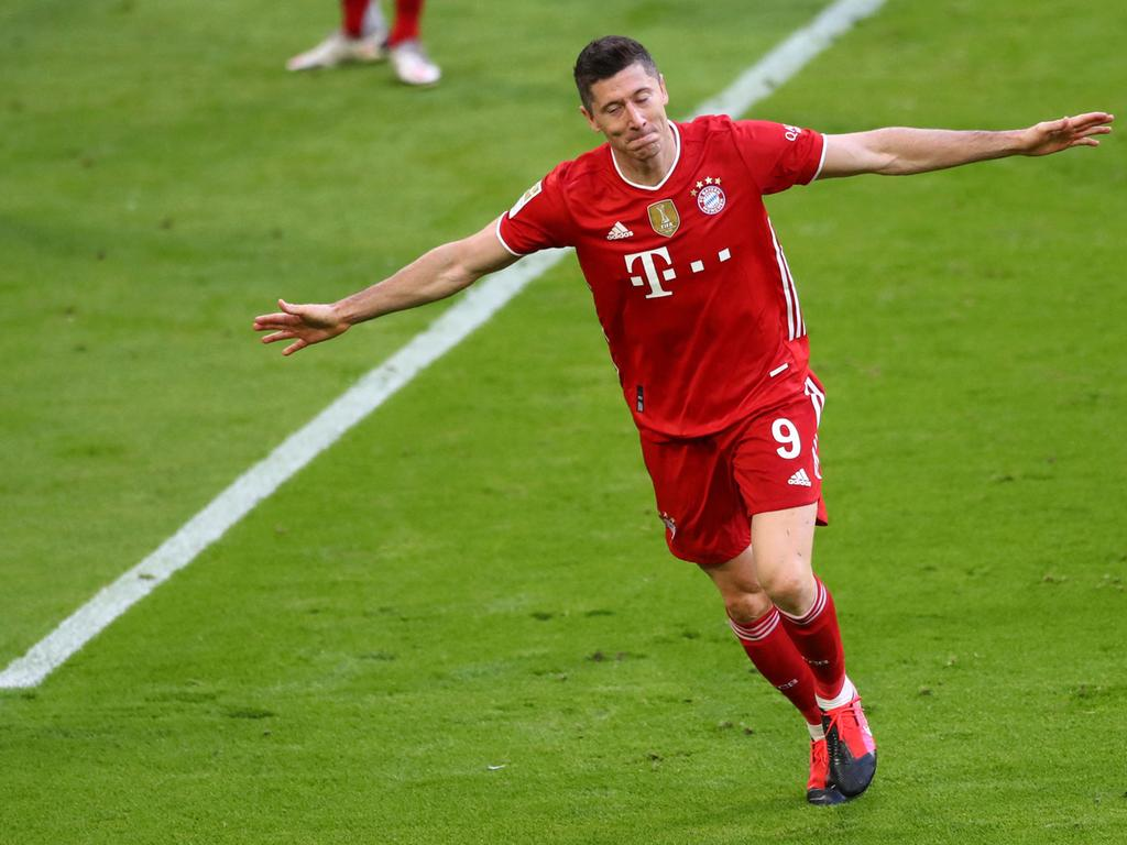 Bayern Munich's Polish forward Robert Lewandowski celebrates after scoring the 3-0 during the German first division Bundesliga football match FC Bayern Munich v Borussia Moenchengladbach in Munich, southern Germany on May 8, 2021. (Photo by MATTHIAS SCHRADER / POOL / AFP) / DFL REGULATIONS PROHIBIT ANY USE OF PHOTOGRAPHS AS IMAGE SEQUENCES AND/OR QUASI-VIDEO   ALTERNATIVE CROP