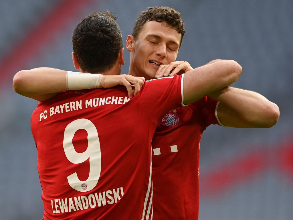 Bayern Munich's Polish forward Robert Lewandowski celebrates scoring the opening goal with his teammate Bayern Munich's French defender Benjamin Pavard (R) during the German first division Bundesliga football match FC Bayern Munich v Borussia Moenchengladbach in Munich, southern Germany on May 8, 2021. - Bayern Munich won the Bundesliga for the ninth time in a row after Leipzig lost to Dortmond earlier in the day. (Photo by CHRISTOF STACHE / POOL / AFP) / DFL REGULATIONS PROHIBIT ANY USE OF PHOTOGRAPHS AS IMAGE SEQUENCES AND/OR QUASI-VIDEO