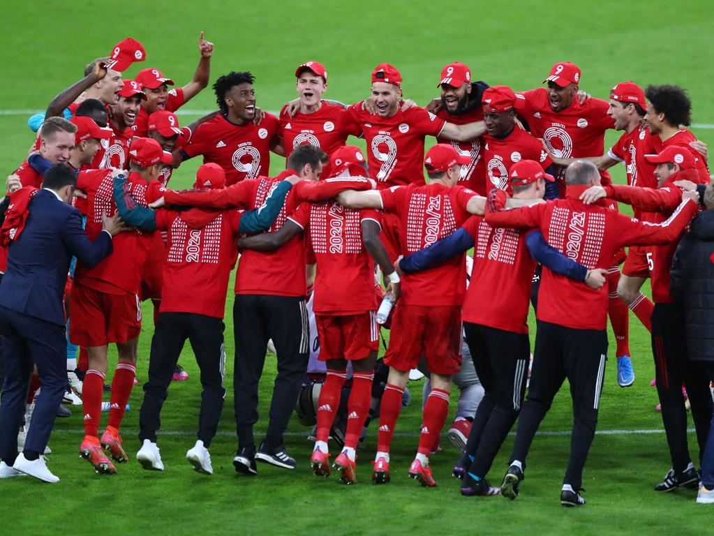 Bayern Munich's players and team members celebrate after they won the German first division Bundesliga football match FC Bayern Munich v Borussia Moenchengladbach in Munich, southern Germany on May 8, 2021. - Bayern Munich were confirmed as Bundesliga champions for the ninth straight season after Borussia Dortmund beat second-placed RB Leipzig 3-2. (Photo by MATTHIAS SCHRADER / POOL / AFP) / DFL REGULATIONS PROHIBIT ANY USE OF PHOTOGRAPHS AS IMAGE SEQUENCES AND/OR QUASI-VIDEO
