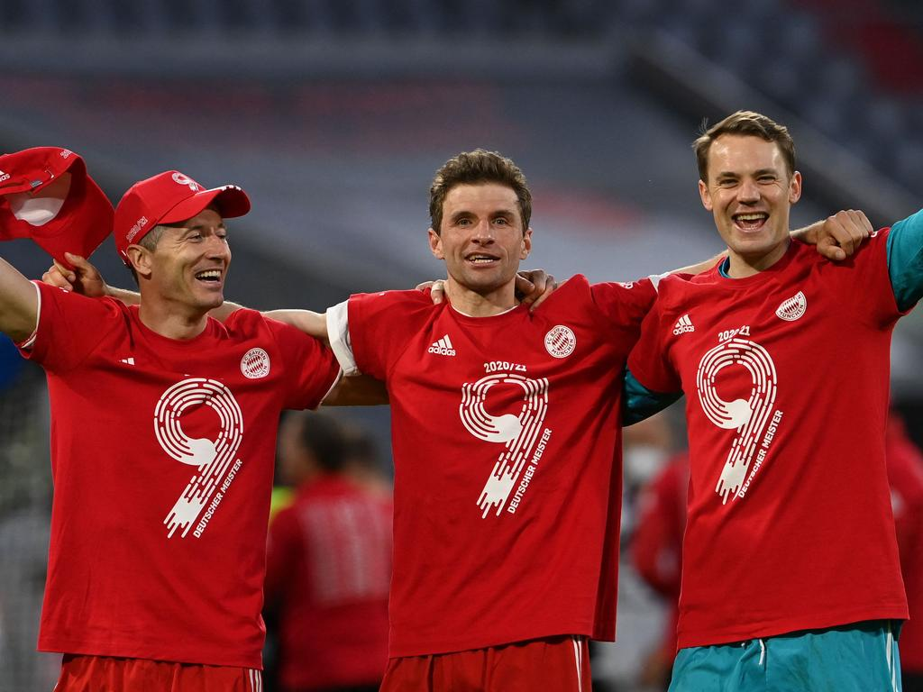 (L-R) Bayern Munich's Polish forward Robert Lewandowski, Bayern Munich's German forward Thomas Mueller and Bayern Munich's German goalkeeper Manuel Neuer celebrate after the German first division Bundesliga football match FC Bayern Munich v Borussia Moenchengladbach in Munich, southern Germany on May 8, 2021. - Bayern Munich won the Bundesliga for the ninth time in a row after Leipzig lost to Dortmond earlier in the day. (Photo by CHRISTOF STACHE / POOL / AFP) / DFL REGULATIONS PROHIBIT ANY USE OF PHOTOGRAPHS AS IMAGE SEQUENCES AND/OR QUASI-VIDEO