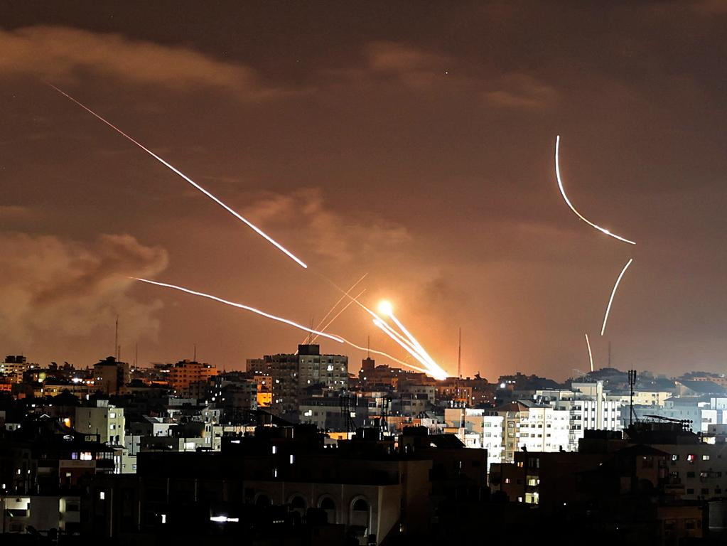 Rockets are launched from Gaza City, controlled by the Palestinian Hamas movement, towards Israel on May 12, 2021, amid the most intense Israeli-Palestinian hostilities in seven years. (Photo by MAHMUD HAMS / AFP)
