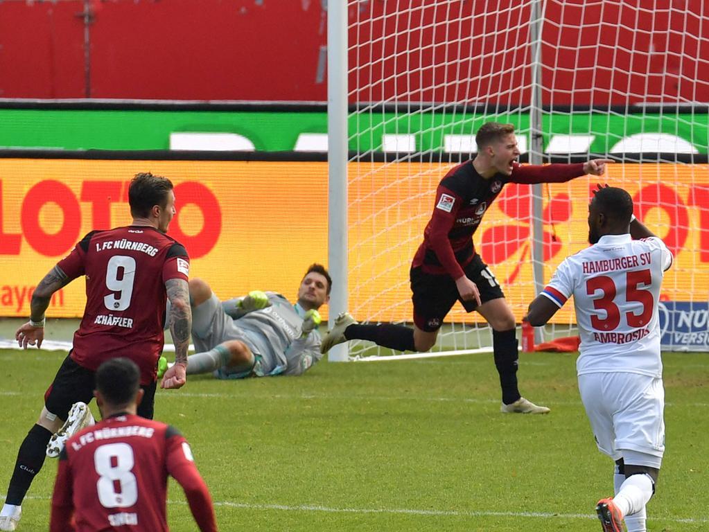 09.01.2021, xblx, Fussball 2.Bundesliga, 1. FC Nuernberg - Hamburger SV emspor, v.l. Fabian Nuernberger 1. FC Nuernberg, Goal scored, Tor zum 1:0, celebrate the goal, Torjubel DFL/DFB REGULATIONS PROHIBIT ANY USE OF PHOTOGRAPHS as IMAGE SEQUENCES and/or QUASI-VIDEO Nuernberg *** 09 01 2021, xblx, football 2 Bundesliga, 1 FC Nuernberg Hamburger SV emspor, v l Fabian Nuernberger 1 FC Nuernberg , Goal scored, Tor zum 1 0, celebrate the goal, Torjubel DFL DFB REGULATIONS PROHIBIT ANY USE OF PHOTOGRAPHS as IMAGE SEQUENCES and or QUASI VIDEO Nuernberg