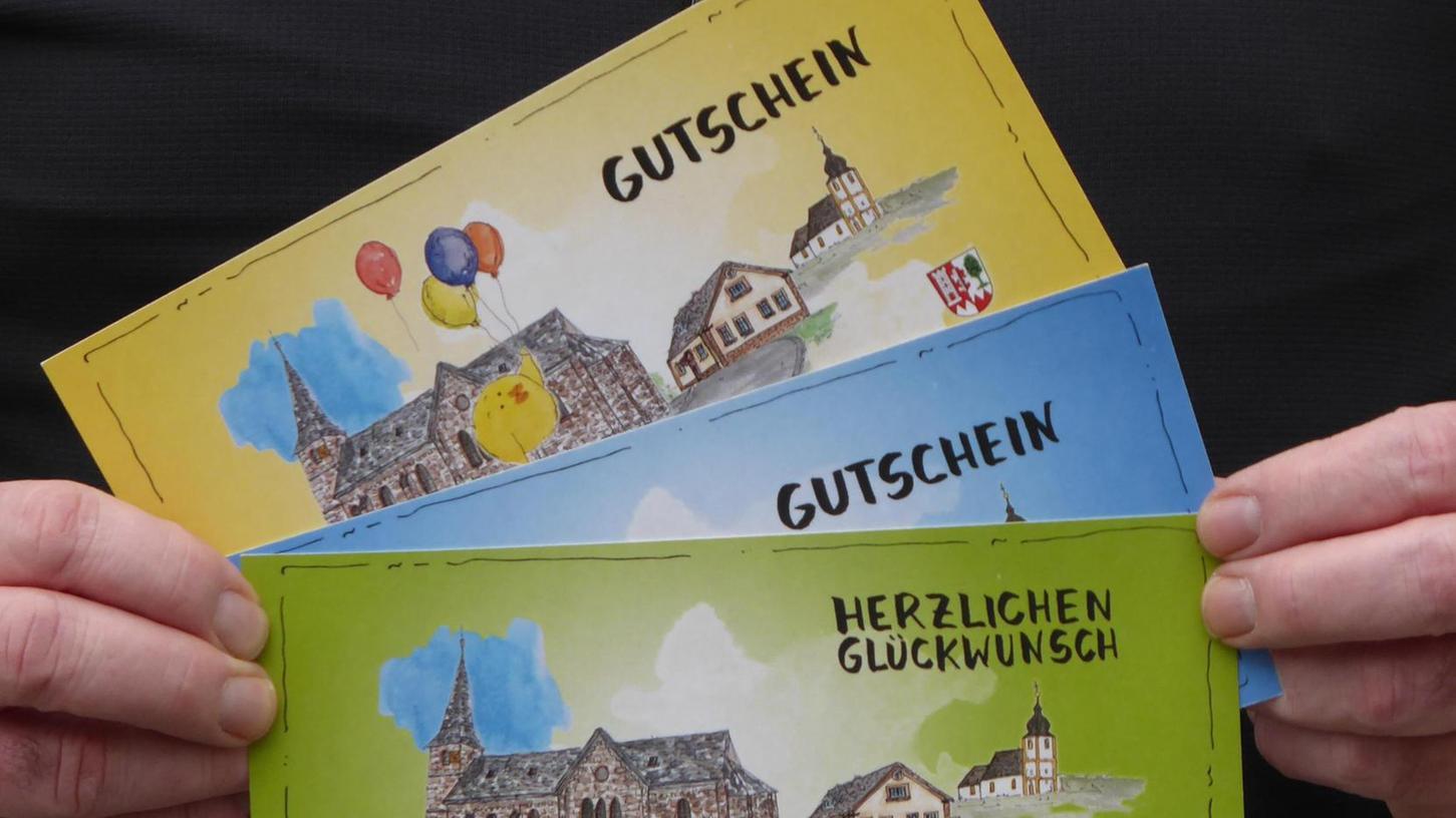 Der Weilersbach-Gutschein ist in drei Farben erhältlich und soll die Kaufkraft im Ort halten.