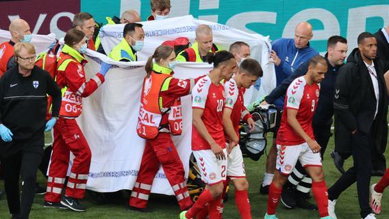 Dieses Foto zeigt, wie Christian Eriksen hinter Tüchern abtransportiert wird.