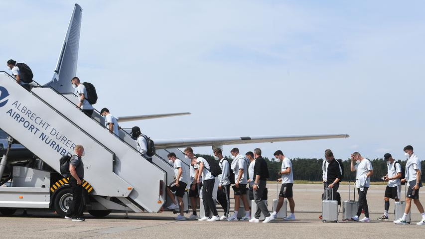 Germany's players and staff board a plane on the tarmac of Nuremberg Airport, on June 28, 2021, as they travel to the United Kingdom on the eve of their UEFA EURO 2020 football match against England, played at Wembley Stadium in London. (Photo by Christof STACHE / AFP)