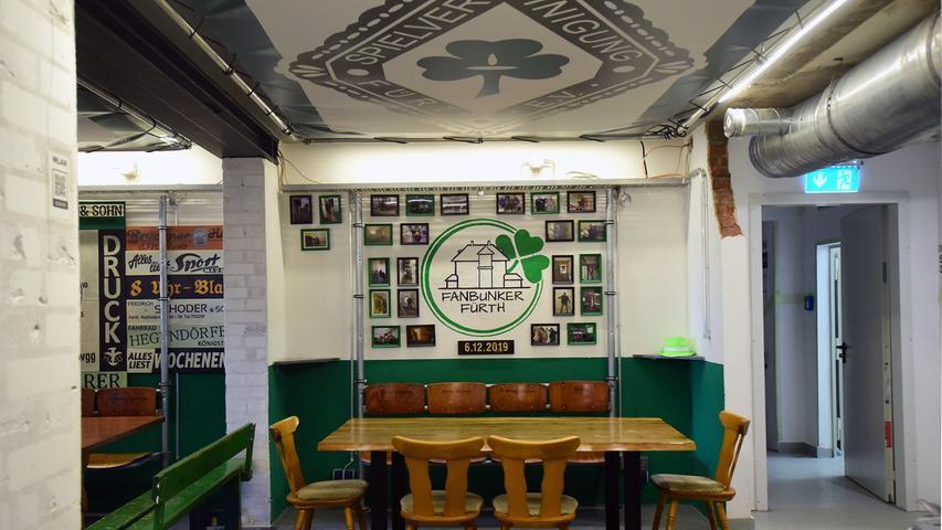 Die Wände zieren auch jede Menge Fotos aus der langen und staubigen Umbauzeit, in der aus dem ehemaligen Hochbunker die neue Heimat der Kleeblattfans wurde.