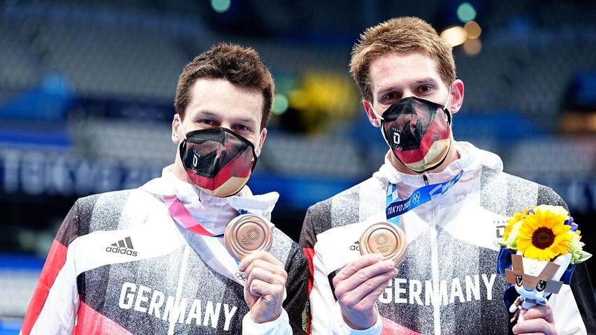 Fahnenträger Patrick Hausding und Lars Rüdiger sicherten sich im Synchronspringen vom Drei-Meter-Brett Rang drei hinter den Chinesen und den US-Amerikanern. Bronze für Deutschland!
