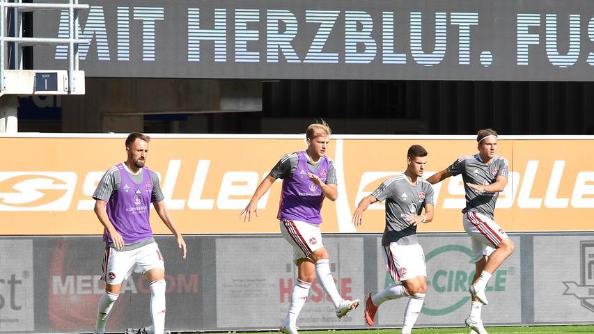 30.07.2021 --- Fussball --- Saison 2021 2022 --- 2. Fussball - Bundesliga --- 02. Spieltag: SC Paderborn 07 - 1. FC Nürnberg FCN ( Club ) --- Foto: 1. FC Nürnberg / WoZi --- DFL regulations prohibit any use of photographs as image sequences and/or quasi-video - ....von links : Florian Hübner Huebner (19, 1. FC Nürnberg / FCN ) Johannes Geis (5, 1. FC Nürnberg / FCN ) Tom Krauß Krauss (14, 1. FC Nürnberg / FCN ) Felix Lohkemper (7, 1. FC Nürnberg / FCN )