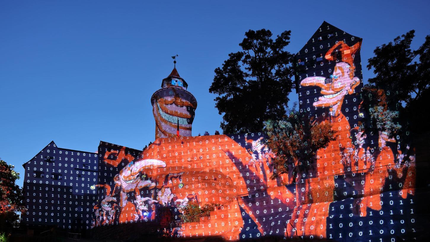 Kasperlestheater um die Kaiserburg-Projektion mit Motiven von Peter Angermann.