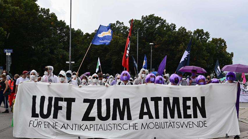 Climate activists march with a banner reading 'Air to breathe' as they protest against the International Motor Show (IAA) at the Theresienwiese in Munich, southern Germany, on September 11, 2021. (Photo by Tobias Schwarz / AFP)