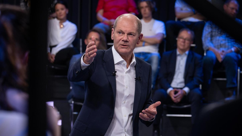 Die SPD mit ihrem Kanzlerkandidaten Olaf Scholz treten auf europäischer Ebene für eineArbeitslosen-Rückversicherung ein.