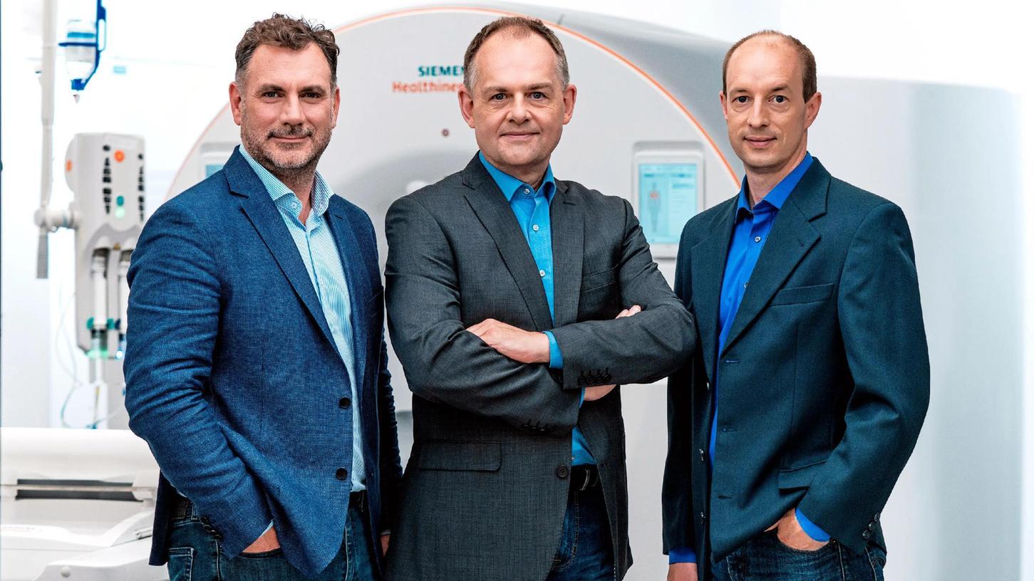 Nominiert für den Deutschen Zukunftspreis 2021:Das Team von Siemens Healthineers mit Stefan Ulzheimer (v.li.) Thomas Flohr und Björn Kreisler.