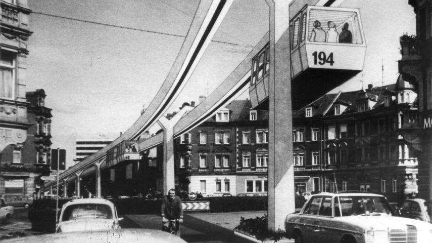 ... andere Argumente. Neben den massiven Veränderungen im Stadtbild, die eine H-Bahn hervorgerufen hätte, wollte die CSU lieber mit dem jahrelang propagierten Ausbau des Kosbacher Dammes die Verkehrsprobleme lösen. Am Ende stimmte der Stadtrat gegen die H-Bahn und begrub sie damit in Erlangen für alle Zeit. Die Fotomontage aus den
