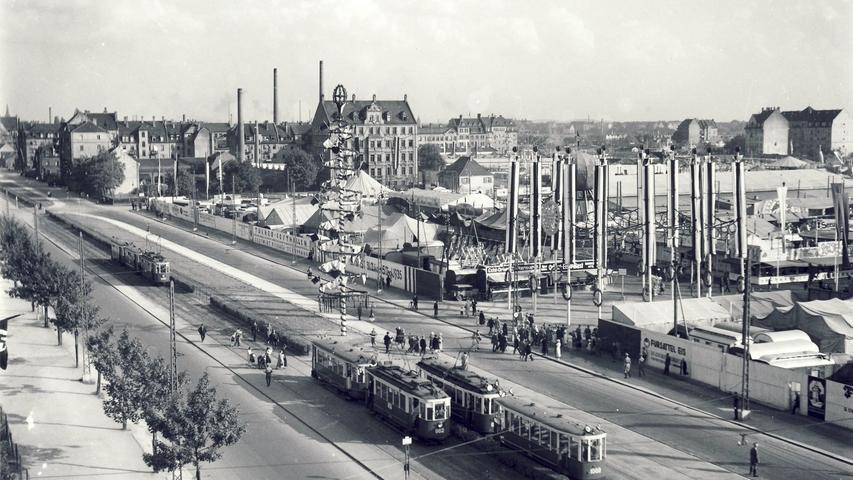 Wo sich heute das Quelle-Gelände in Eberhardshof befindet, war 1935 der Nürnberger Volksfestplatz. Von der Straßenbahn strömten die Menschen zum Volksfest. Damals lag der Platz anders als heute mitten im Wohngebiet.