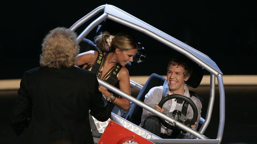 Formel-1-Pilot Sebastian Vettel und das Model Sylvie van der Vaart