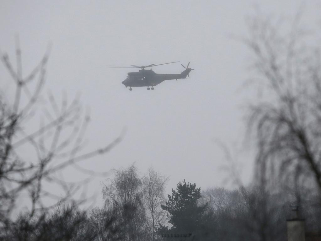 A helicopter flies over Dammartin-en-Goele where shots were fired and at least  one hostage was taken in the same area police were hunting for two brothers  accused of slaughtering 12 people in an Islamist assault, on January 9, 2015.  The hostage drama was underway at a business in Dammartin-en-Goele, to the  north-east of Paris, and came 48 hours into a massive manhunt for the Islamist  gunmen who attacked the Charlie Hebdo offices on January 7. AFP PHOTO / JOEL  SAGET