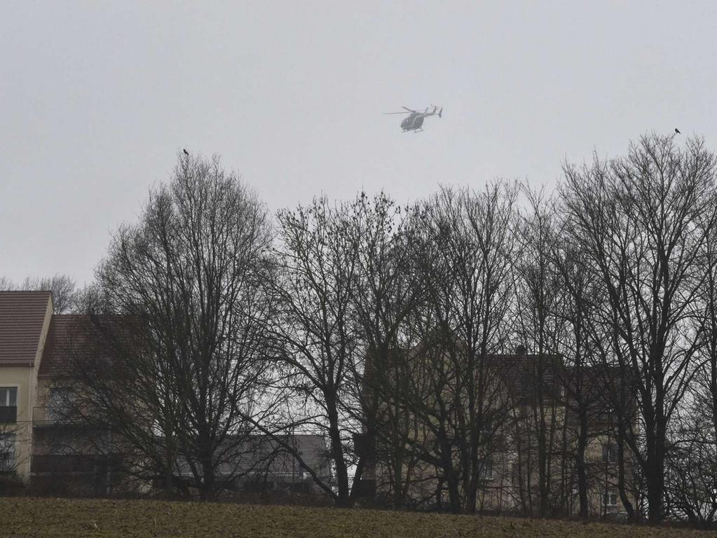 A Eurocopter EC 145 helicopter of the French gendarmerie flies over  Dammartin-en-Goele where shots were fired and at least one hostage was taken in  the same area police were hunting for two brothers accused of slaughtering 12  people in an Islamist assault, on January 9, 2015. The hostage drama was  underway at a business in Dammartin-en-Goele, to the north-east of Paris, and  came 48 hours into a massive manhunt for the Islamist gunmen who attacked the  Charlie Hebdo offices on Wednesday. The suspects were holed up in a small  printing business named CTD, a source close to the investigation said. AFP  PHOTO / DOMINIQUE FAGET