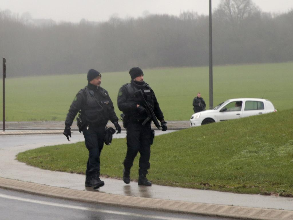 French police patrol in Dammartin-en-Goele where shots were fired and at least  one hostage was taken in the same area police were hunting for two brothers  accused of slaughtering 12 people in an Islamist assault, on January 9, 2015.  The hostage drama was underway at a business in Dammartin-en-Goele, to the  north-east of Paris, and came 48 hours into a massive manhunt for the Islamist  gunmen who attacked the Charlie Hebdo offices on January 7. AFP PHOTO / JOEL  SAGET