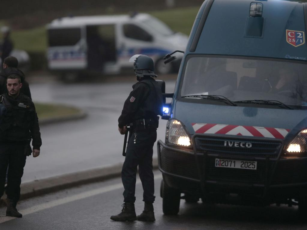 French police and gendarmes patrol in Dammartin-en-Goele where shots were fired  and at least one hostage was taken in the same area police were hunting for two  brothers accused of slaughtering 12 people in an Islamist assault, on January  9, 2015. The hostage drama was underway at a business in Dammartin-en-Goele, to  the north-east of Paris, and came 48 hours into a massive manhunt for the  Islamist gunmen who attacked the Charlie Hebdo offices on January 7. AFP PHOTO  / JOEL SAGET