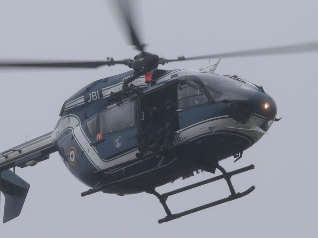 A helicopter of the French Gendarmerie flies over Dammartin-en-Goele where a  hostage-taking was underway after police hunting the Islamist brothers who  killed 12 people earlier this week exchanged fire with two men during a car  chase, on January 9, 2015. Friday's drama unfolded almost 48 hours into a  massive manhunt launched after the brothers burst into the office of the  satirical weekly Charlie Hebdo and gunned down staff members and two policemen,  saying they were taking revenge for the magazine's publication of cartoons  offensive to many Muslims. The number of people seized was not immediately  confirmed. AFP PHOTO / JOEL SAGET